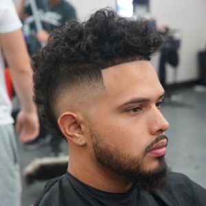 Mohawk Bald Fade Haircut with Long Curls