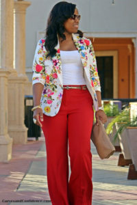 a floral printed blazer with a matching jeans trouser