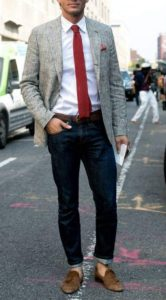 ash blazer with white shirt and long neck tie and dark blue jeans