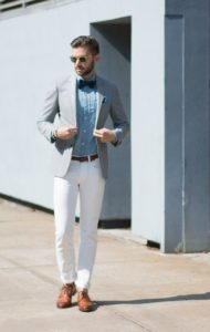 ash blazer with white trouser and sky blue shirt with black bow tie