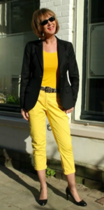 combine black blazer with yellow jumper jeans and yellow top