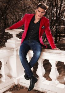 red blazer with black shirt and blue jeans and boot shoe - mens stylish fashion tip
