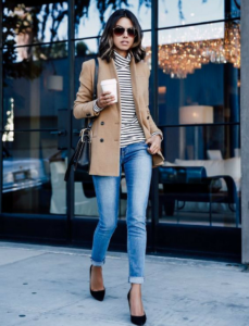 blue ladies denim jeans with brown jacket and glasses