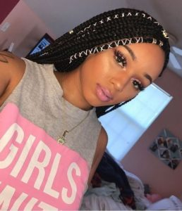 pretty queens black braids hairstyle with white strips
