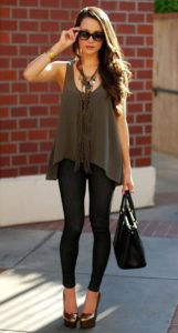 sleeveless blouse with fitting jeans and wedge heel shoes