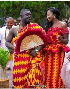 a matching hand fan can also make couples kente outfit unique - etsy