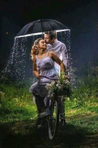 a shot with both on a bicycle while the man kisses the lady's fore head - ngcreation eklablog fr