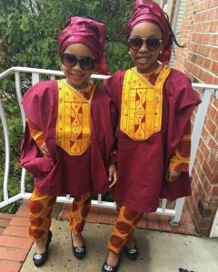 adorable ankara agbada style for kid girls with a matching hair style and sunglasses - stylevitae