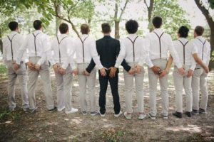 all groomsmen backing the photographer with the groom at the center - offbeatbride