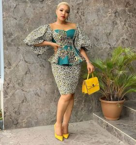 Birthday ladies ankara short skirt and blouse style with low cut hairstyle and matching hand bag and shoes - instagram