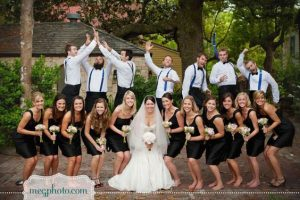 bridal train pose at the front while groomsmen pose at the back - bridalguide