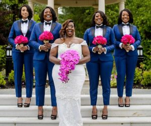 brides train on blue trouser suits with bow tie while bride pose with her wedding dress and flower - buzzfeed