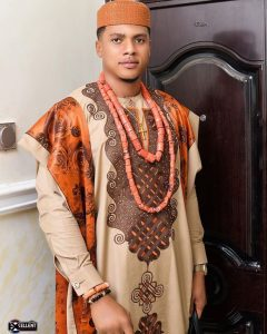 classic ankara agbada style with neck beads - instagram