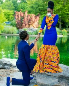 engagement with the groom on navy blue while the lady rocks a similar blue gown with kente fabric design - etsy