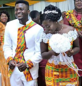 enticing plain suit with stylish touch of kente for the groom - the lady in full kente outfit with lace design - momoafrica