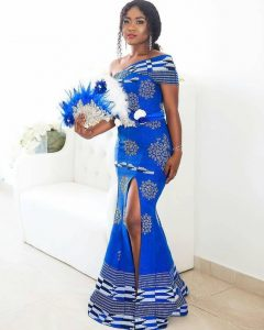envious one shoulder long split kente gown with a matching hand fan - momoafrica