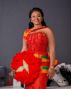 ghana royal brides traditional wedding kente attire with a shade of red - instagram