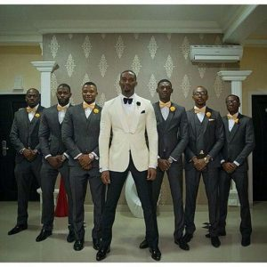 groom on a different suit colour all lined up in v shape - voxlocalis net