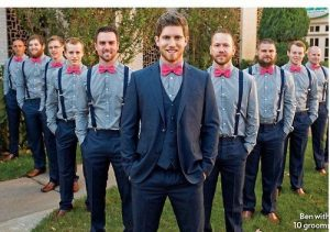 groomsmen lined up in v shape with groom at the center - bridalore