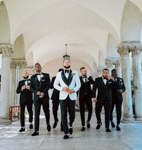 groomsmen on suit walking majestically as camera man takes the shot - youandbigday