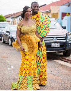 john dumelo on a photo shoot slay with his wife both on kente outfit - mammypi