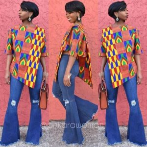 lady slaying with a combination of kente blouse with jeans trousers - ykmmedia