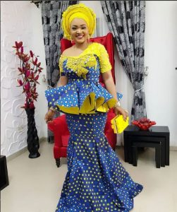 mercy aigbe gorgeous ankara skirt and peplum blouse outfit with a yellow purse - nairaland