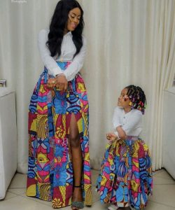 mum teaching her daughter how to slay with a long ankara skirt - etsy