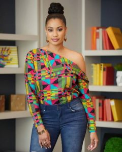 perfect combination of kente one shoulder blouse with jeans trousers - instagram