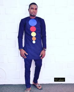 simple navy blue long sleeve senator suit with multicolour circles design - instagram