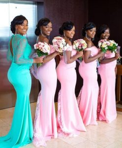 they posed in a pink gown while the bride wears a green gown - pinterest