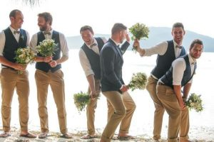 they wore waistcoats holding flowers and posing like ladies - polkadotbride
