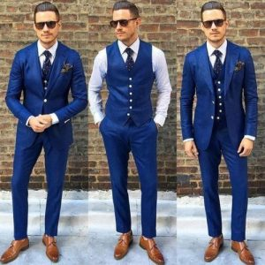 two groomsmen wear complete navy blue suit set while groom wears only waistcoat all wearing sun glasses - rover ebay