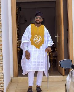 white ankara agbada with gold lions head embroidery and black cap for men - couturecrib
