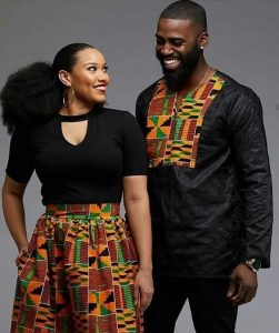 you can make your wedding outfit outstanding with a kente palazzo trouser and black polo - the groom can rock black senator with kente design - blog stylishgwinafrica