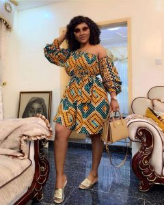 mercy aigbe stylish short flay gown with puffed sleeves