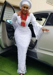 unique ankara lace skirt and blouse with gele hair tie for traditional wedding and church