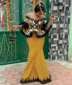 ankara lace off shoulder peplum blouse with long mermaid skirt, hip flay skirt style, with fascinator hair piece