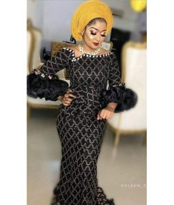 trending ankara lace long gown with puffed sleeve, with gele hair tie, wedding fashion style