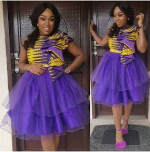 two steps short ankara flay gown with stylish sleeves