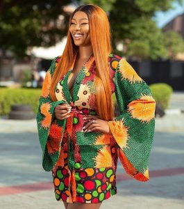 classy ladies ankara short wrapped gown with long hanging funnel sleeves