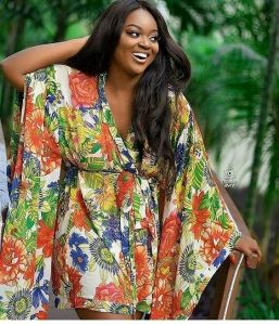 jackie appiah spotted wearing short ankara wrapped gown with long hanging sleeves, african celebrity fashion style