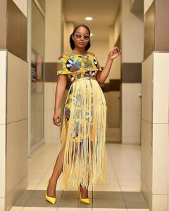 ankara short gown with fringes from waist region for cute ladies