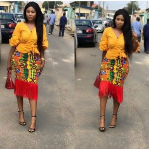 classy ankara pencil skirt with fringes, rocked with cute blouse, for curvy young ladies