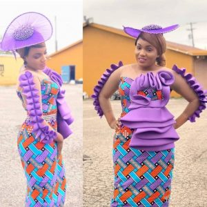 stylish ankara long gown with fascinator hat