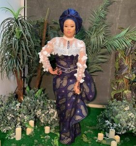 ankara lace long gown with gele hie tie for traditional wedding