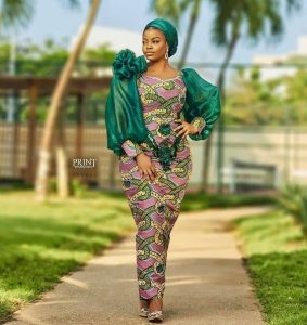 cute ankara long gown style with puffed sleeve for church and wedding