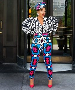 ankara blouse and trousers with fascinator hair piece for classy young ladies