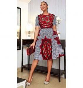 simple but cute ankara short gown with a matching purse, for young ladies, for church and wedding