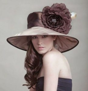 classy fascinator hat style with rose flower design for long hair